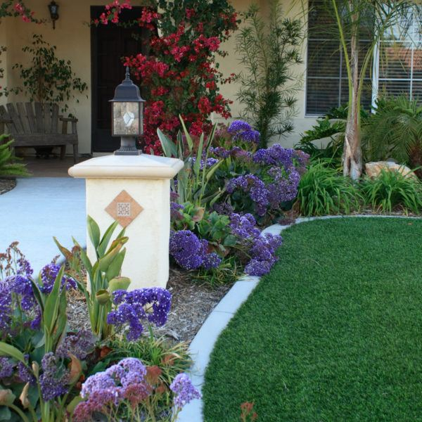 exterior of the front yard of a customer's home with an artificial turf installation