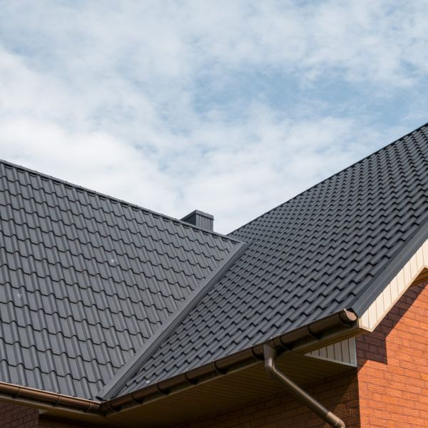 close up of roof with modern, metal shingles
