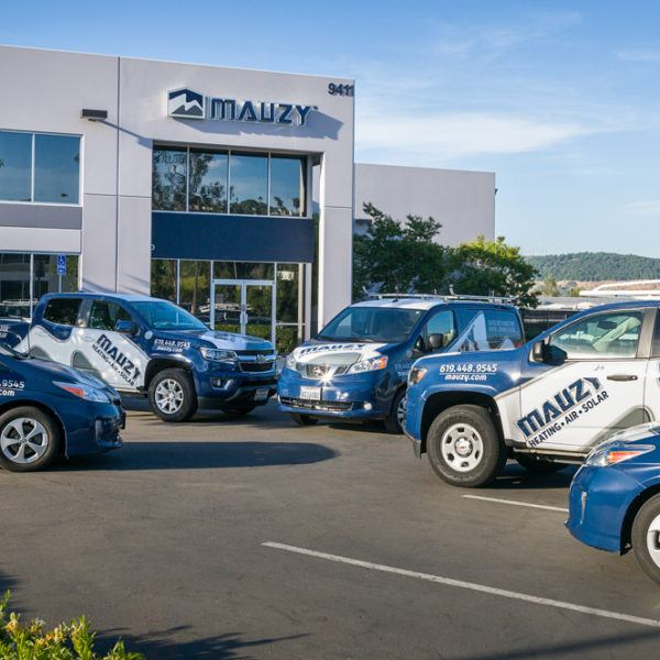 fleet of Mauzy company vehicles parked outside Mauzy offices
